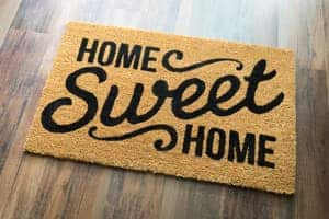 get the feng shui energy moving: shake out your doormat